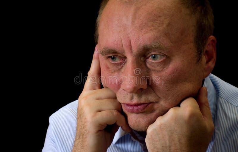 Homem maduro com desespero na cara foto de stock royalty free