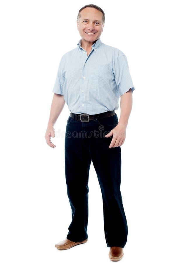 Homem maduro feliz isolado sobre um branco fotografia de stock royalty free