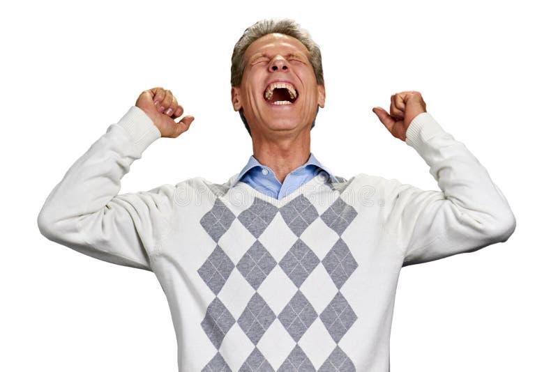 Homem maduro satisfeito com punhos apertados imagem de stock royalty free