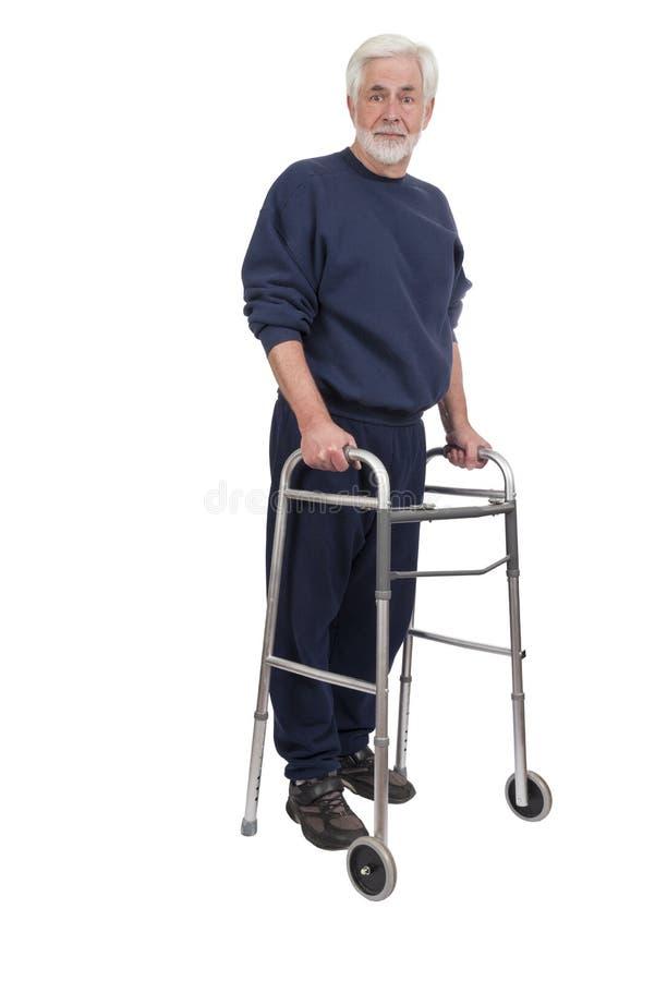 Homem mais idoso alegre com Walker Is Isolated On White fotografia de stock