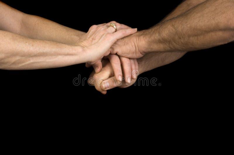 Homem & mulher que clasping as mãos fotos de stock