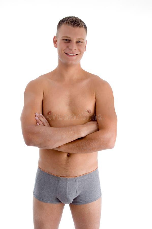 Homem muscular com braços cruzados imagem de stock royalty free