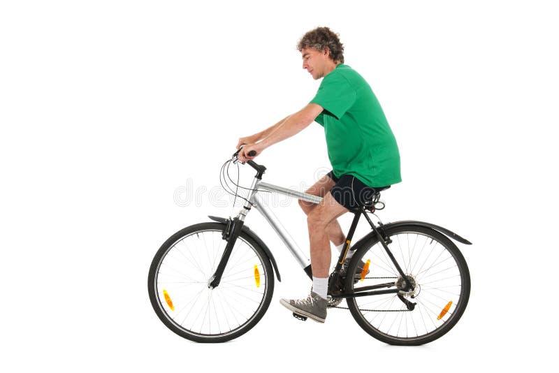 Homem na bicicleta no estúdio fotografia de stock