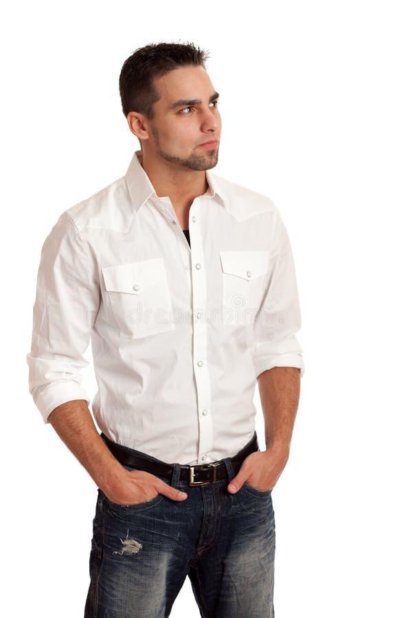 Homem na camisa e nas calças de brim brancas fotos de stock