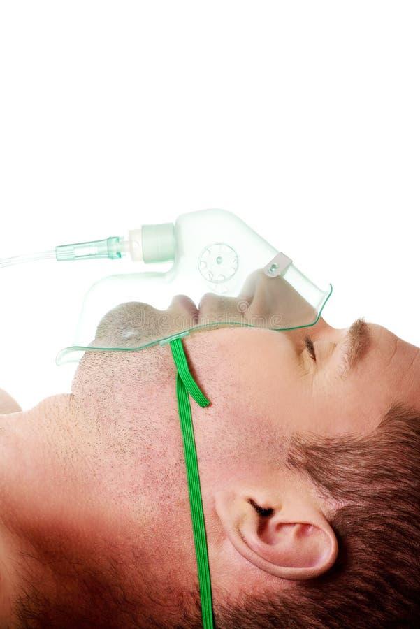 Homem na máscara com oxigênio fotos de stock