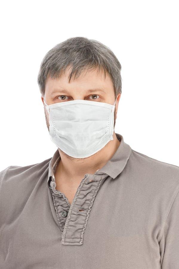 Homem na máscara médica foto de stock
