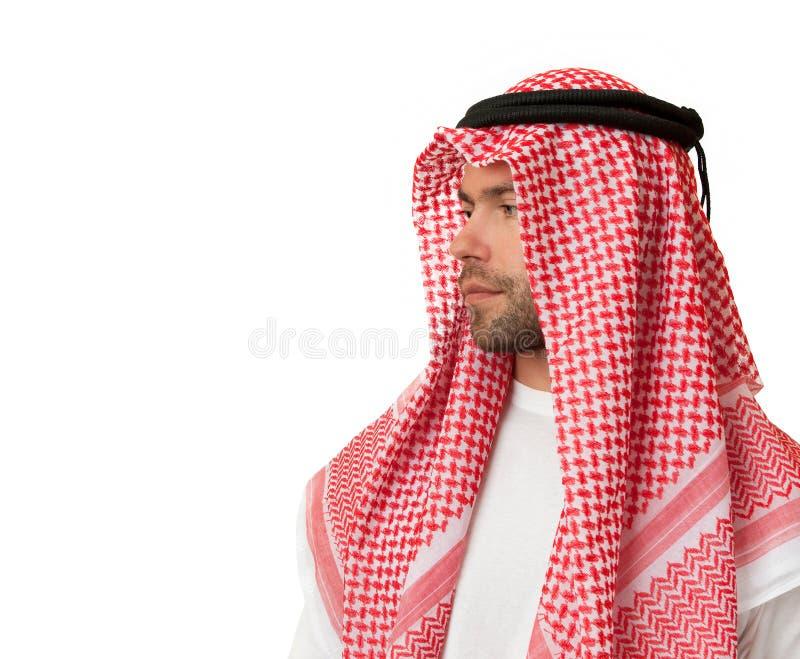 Homem na mantilha árabe. imagens de stock