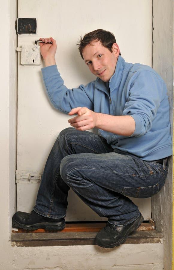 Homem na porta fotografia de stock