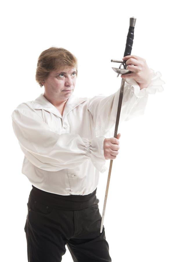 Homem na roupa medieval com espada imagem de stock royalty free