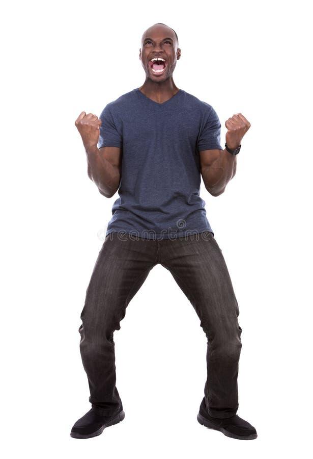 Homem negro considerável que grita com excitamento fotografia de stock