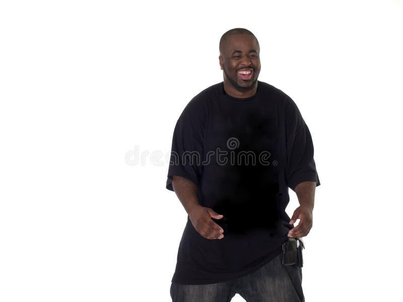 Homem negro novo com sorriso grande fotografia de stock