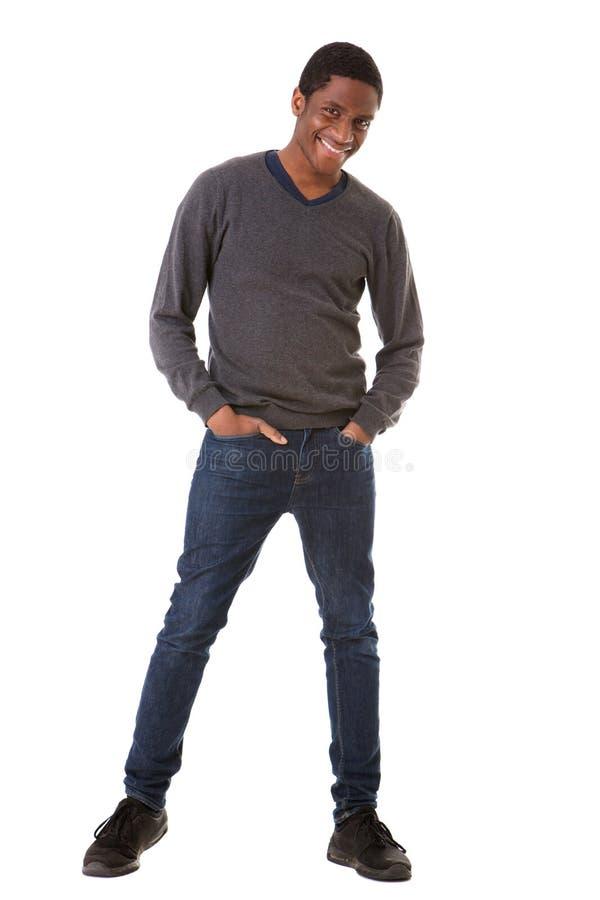 Homem negro novo fresco do comprimento completo que está contra o fundo branco isolado fotos de stock royalty free