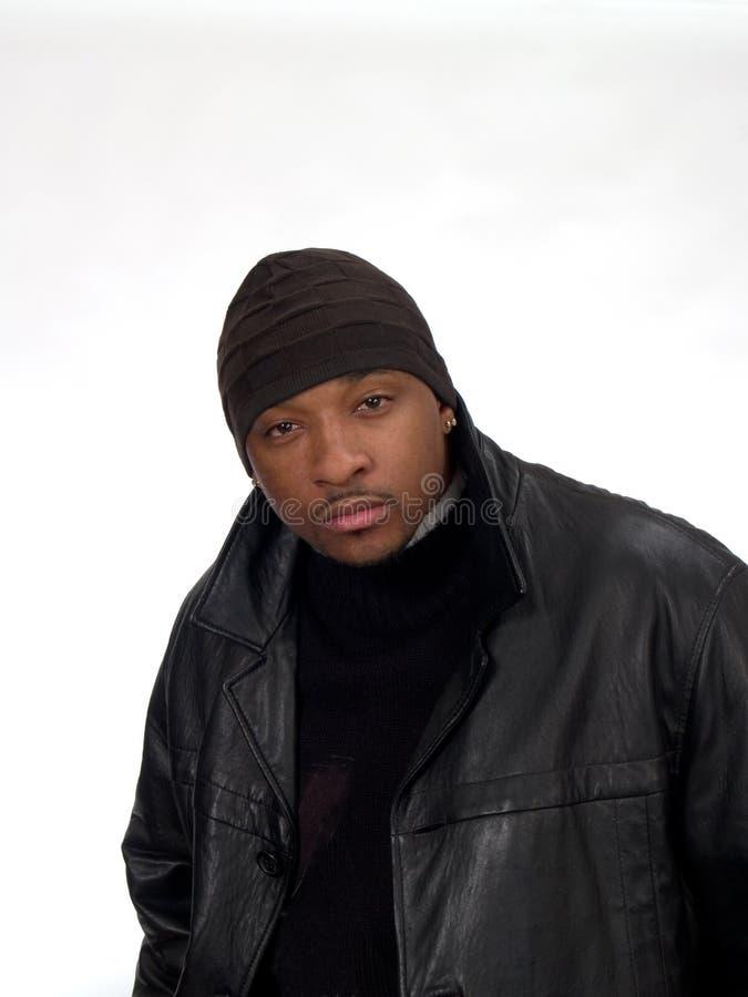 Homem negro novo no tampão fotos de stock royalty free