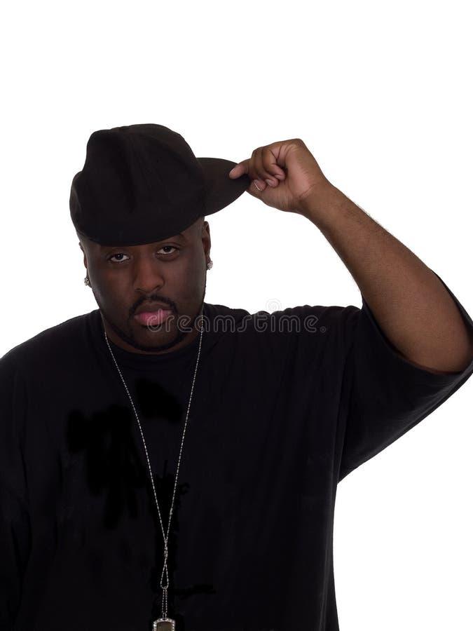Homem negro novo no tampão fotografia de stock