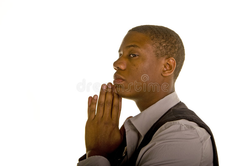 Homem negro novo que Praying ao lado fotografia de stock royalty free