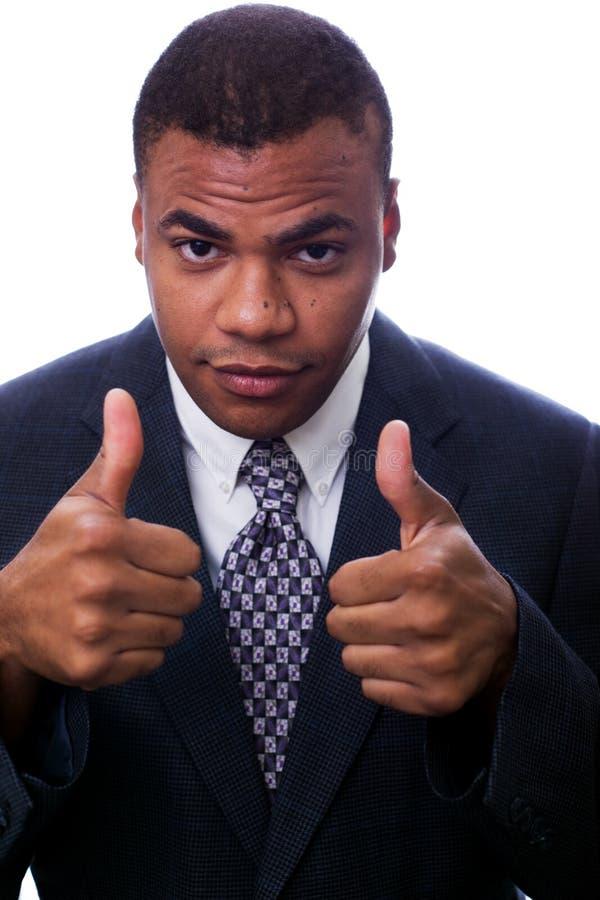 Homem negro que dá os polegares acima foto de stock royalty free