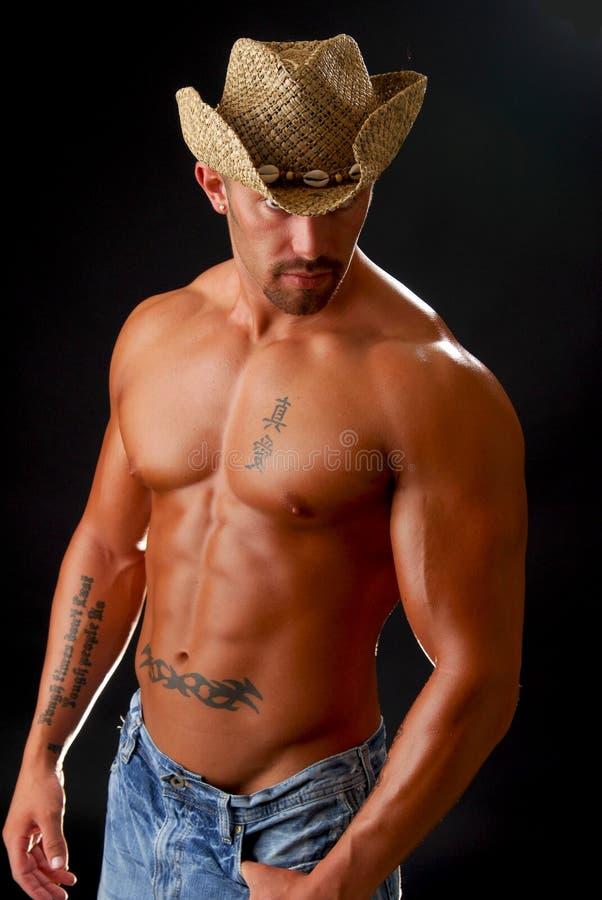 Homem no chapéu de cowboy fotografia de stock royalty free