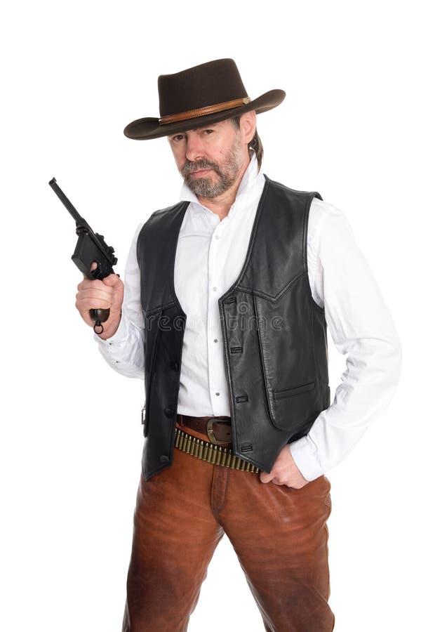 Homem no chapéu de cowboy com injetor fotografia de stock