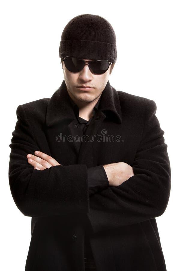 Homem no revestimento e em óculos de sol pretos fotos de stock royalty free