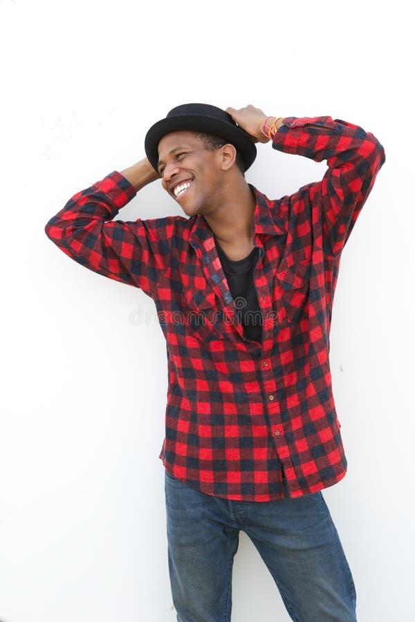 Homem novo alegre que ri fora foto de stock royalty free