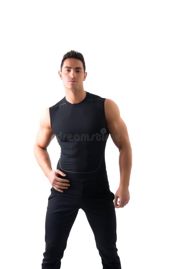 Homem novo atlético considerável no t-shirt preto fotografia de stock royalty free