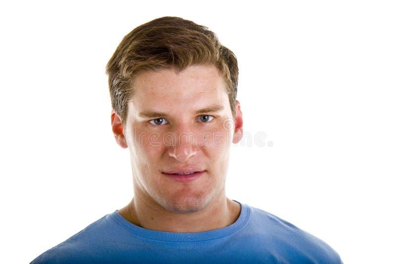 Homem novo atlético no Tshirt azul fotos de stock