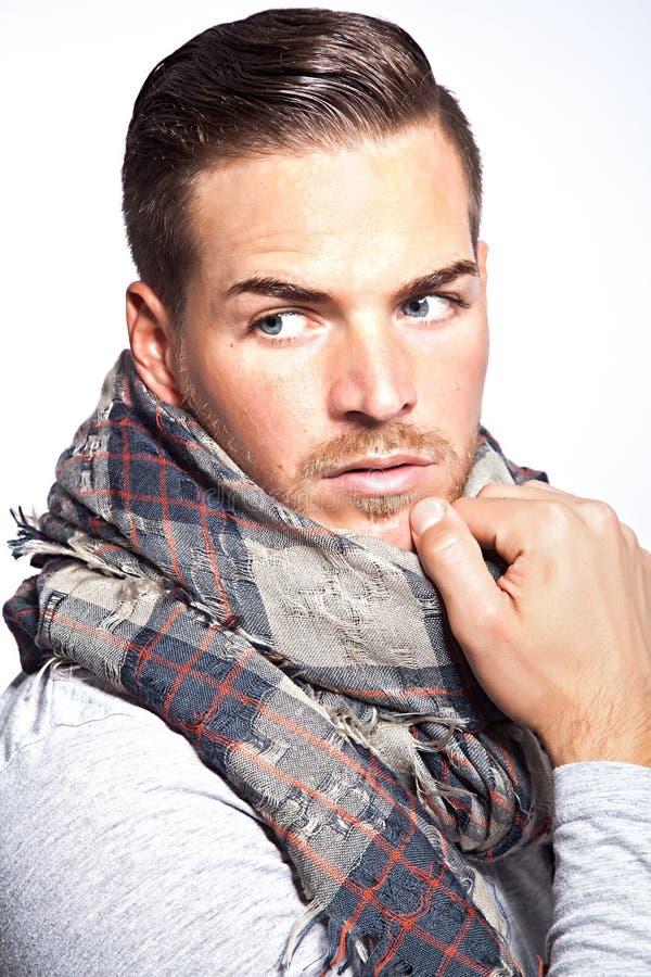 Homem novo bonito com lenço imagem de stock royalty free
