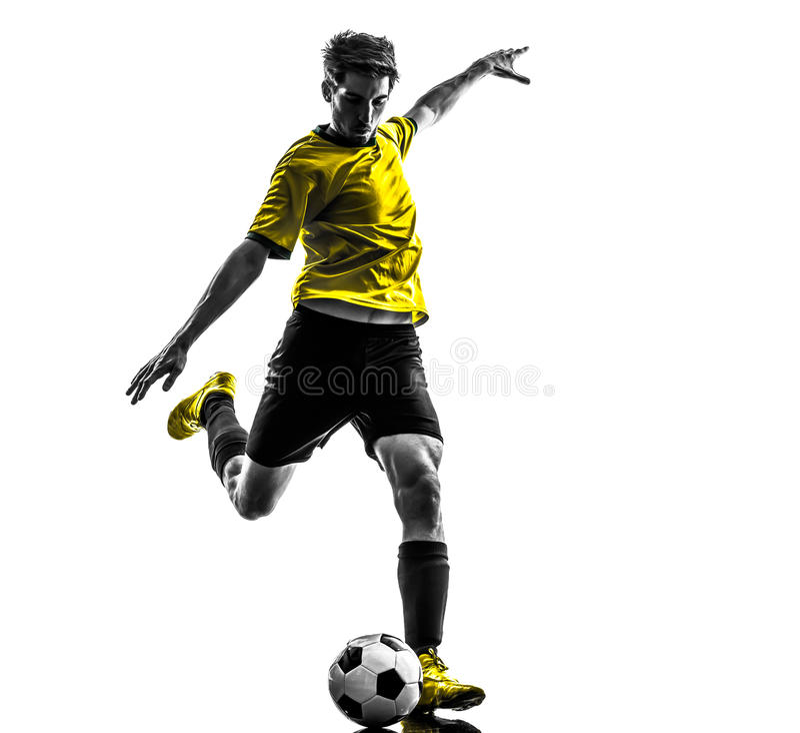 Homem novo brasileiro de jogador de futebol do futebol que retrocede a silhueta imagens de stock