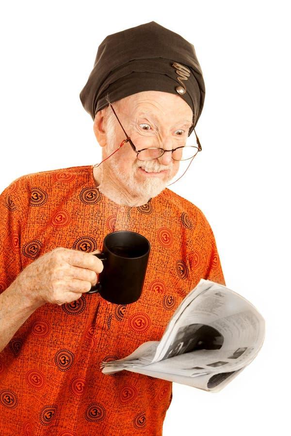 Homem novo céptico da idade com café foto de stock