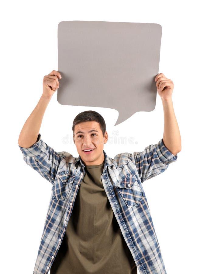Homem novo com bolha do discurso no fundo branco imagens de stock