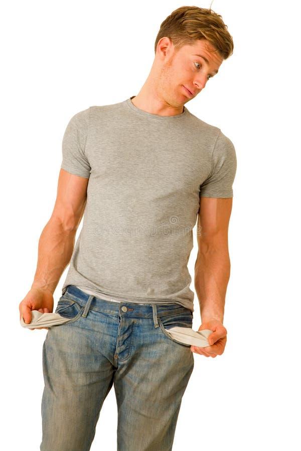 Homem novo com bolsos vazios fotografia de stock