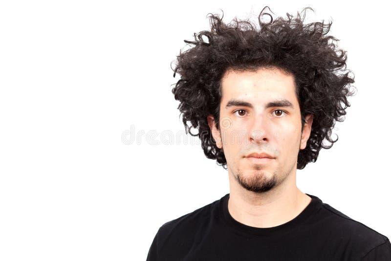 Homem novo com cabelo curly foto de stock royalty free