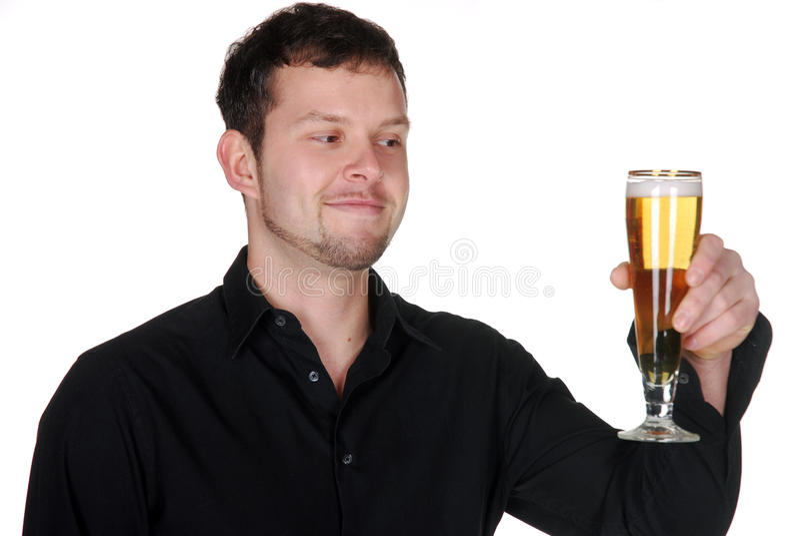 Homem novo com cerveja foto de stock