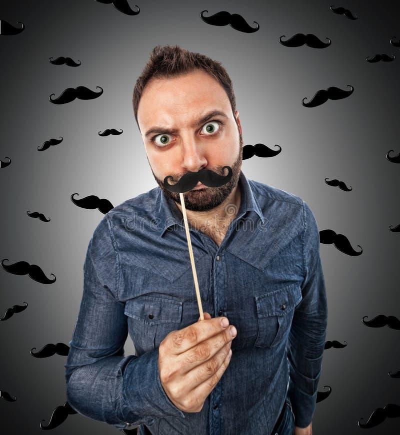 Homem novo com o bigode dado forma cabine da foto foto de stock royalty free