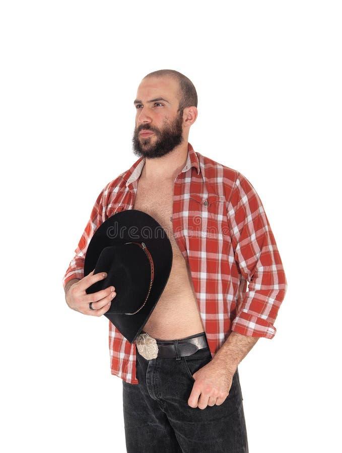 Homem novo com o chapéu aberto da camisa e de vaqueiro foto de stock royalty free