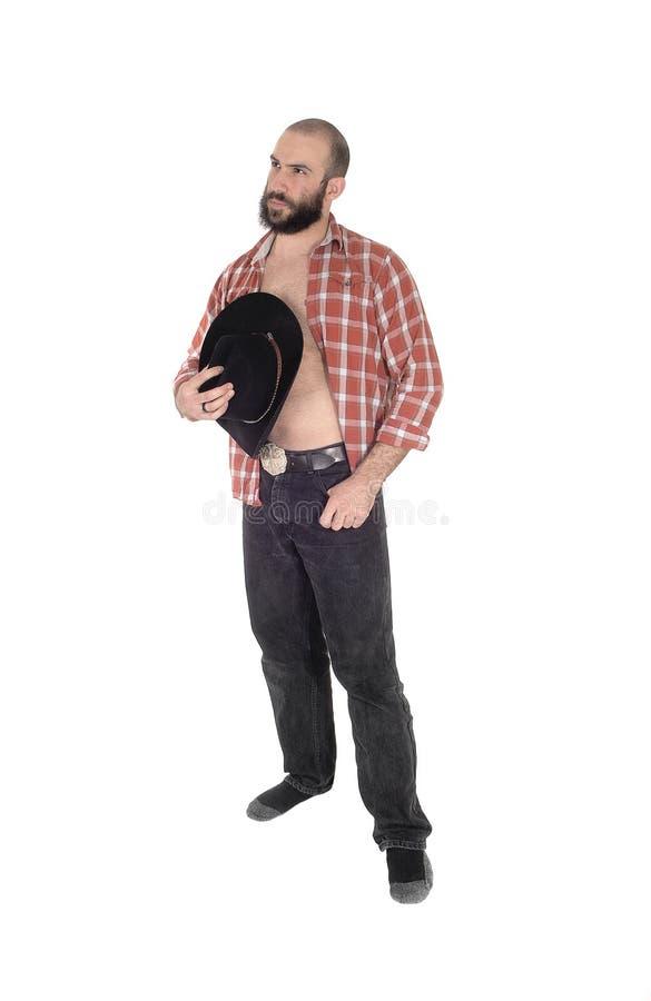 Homem novo com o chapéu aberto da camisa e de vaqueiro fotos de stock