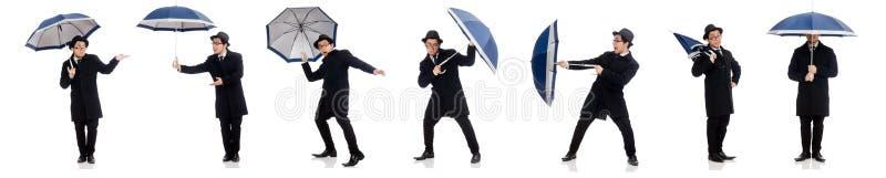 Homem novo com o guarda-chuva isolado no branco imagem de stock royalty free