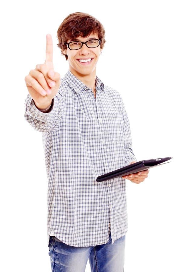 Homem novo com o PC da tabuleta que mostra o forefinger imagem de stock