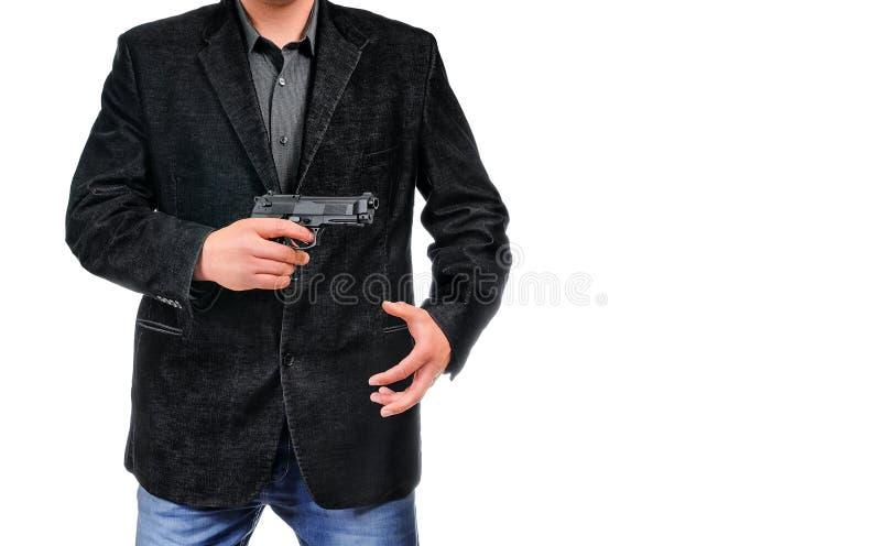 Homem novo com pistola imagens de stock