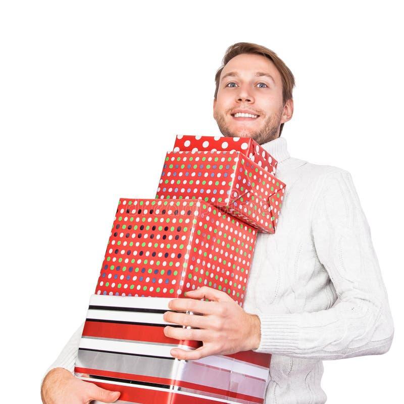 Homem novo com presentes fotografia de stock