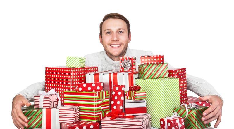Homem novo com presentes fotos de stock