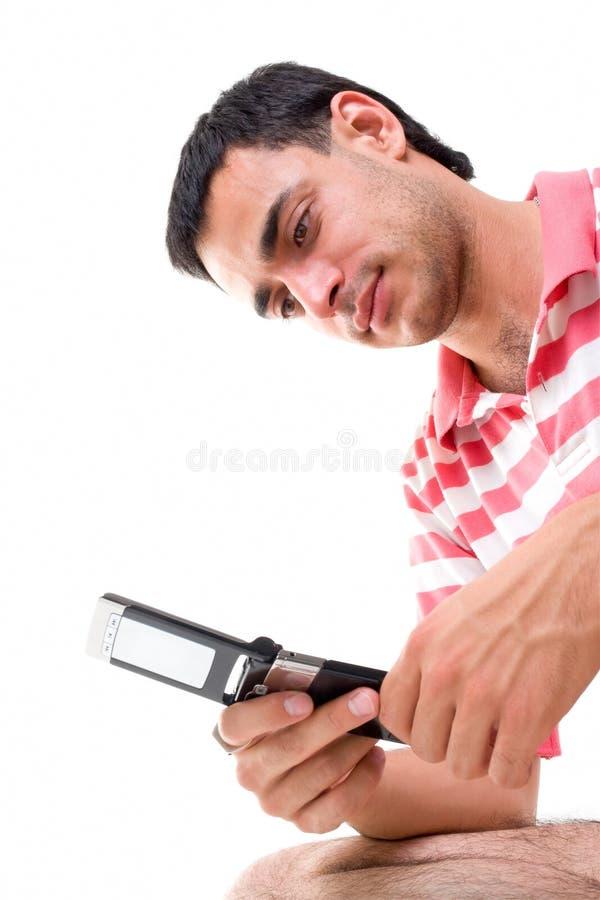 Homem novo com telefone móvel imagem de stock