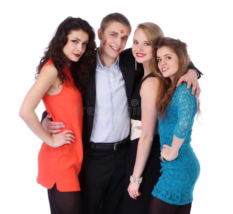 Homem novo com três meninas e beijo-marcas do batom fotografia de stock royalty free
