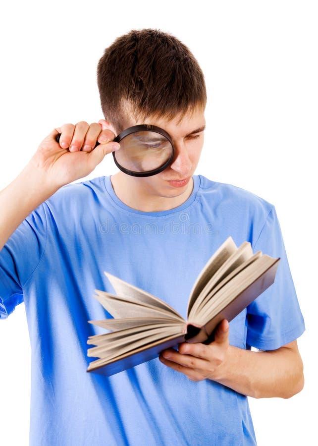 Homem novo com um livro imagem de stock royalty free