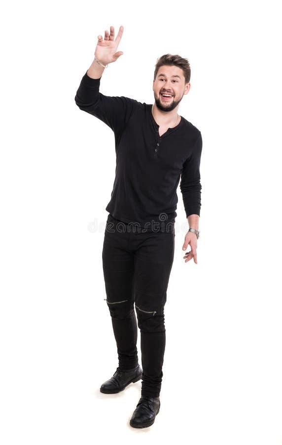 Homem novo considerável de sorriso que levanta no estúdio fotos de stock