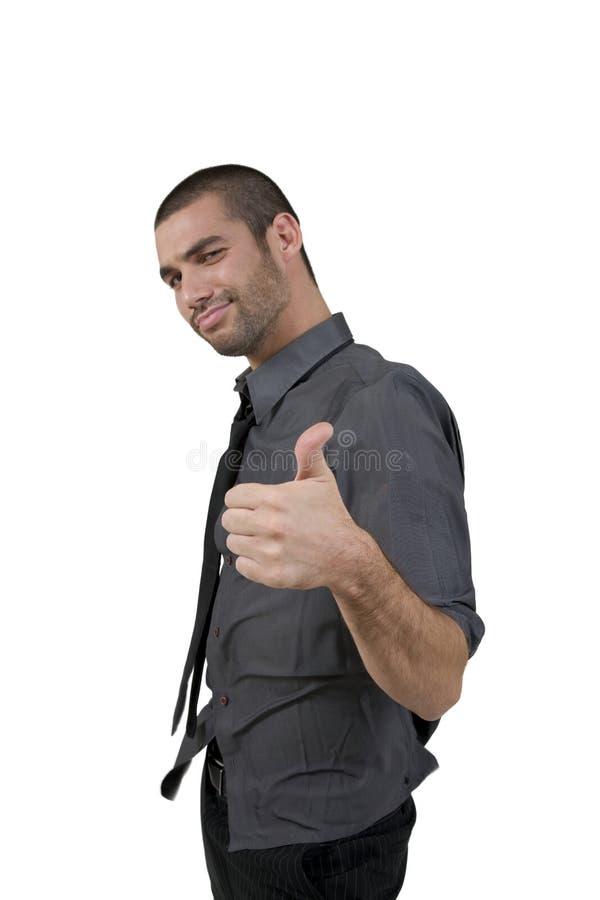 Homem novo considerável que dá a aprovaçã0 fotografia de stock royalty free