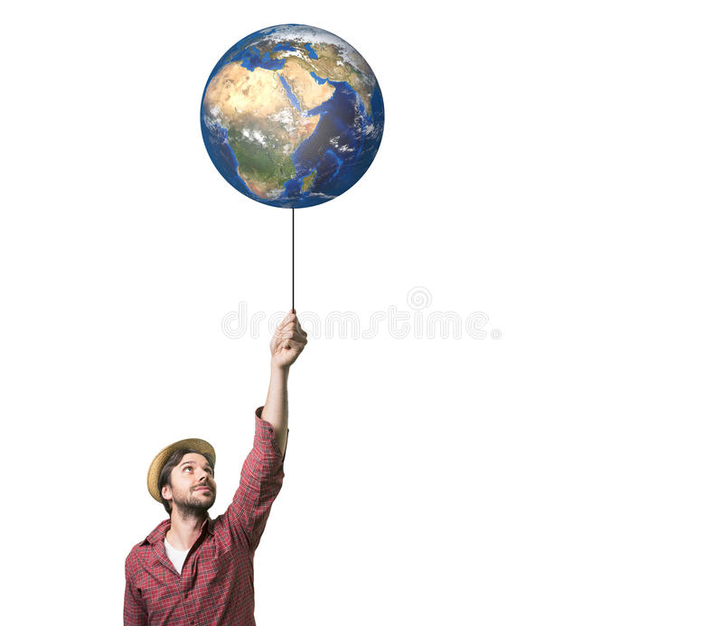 Homem novo considerável que guarda um balão do globo foto de stock