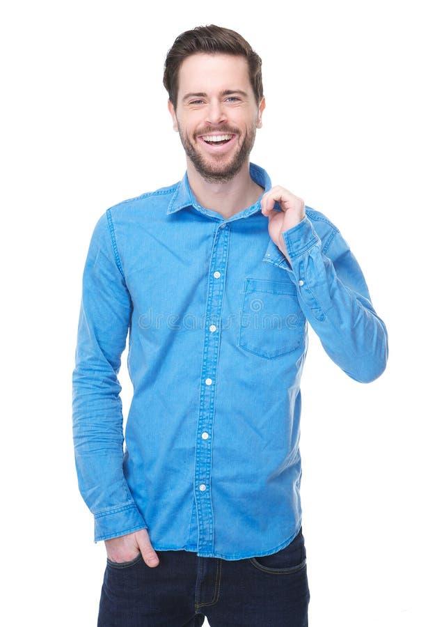 Homem novo considerável que sorri na camisa azul imagens de stock