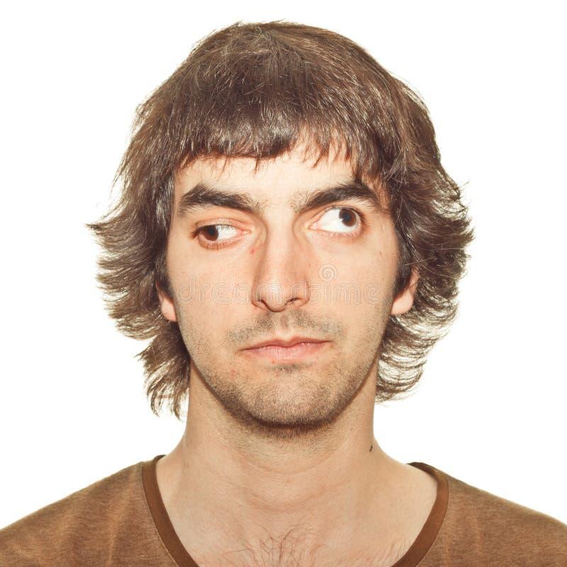 Homem novo Cross-eyed imagens de stock