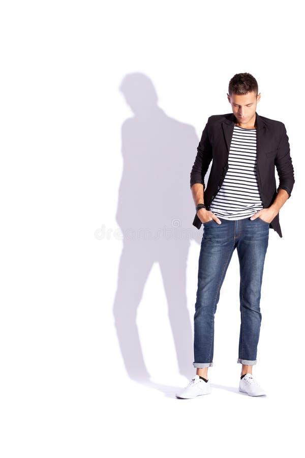 Homem novo da forma que olha para baixo fotos de stock